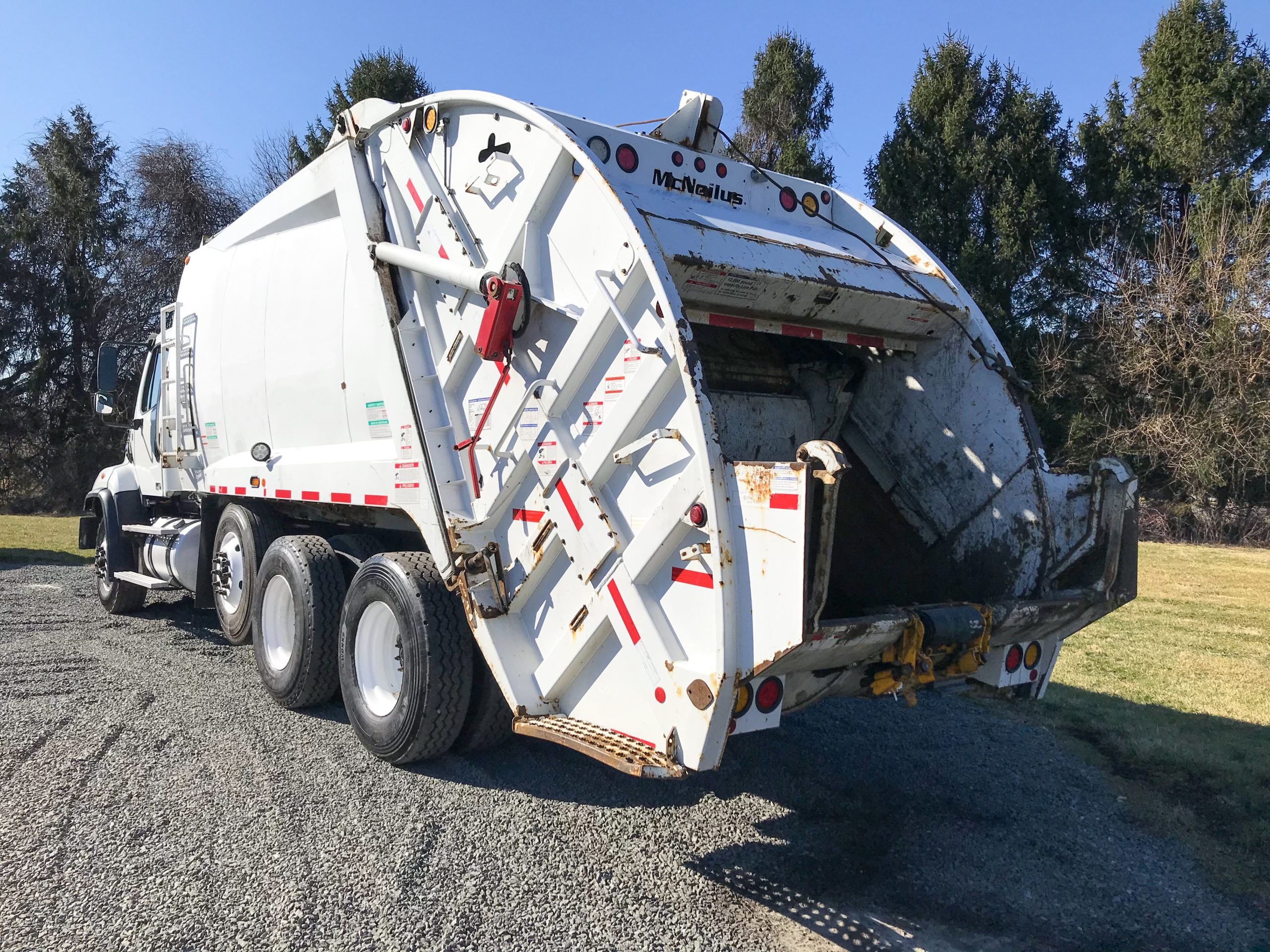 mcneilus rear loader garbage truck